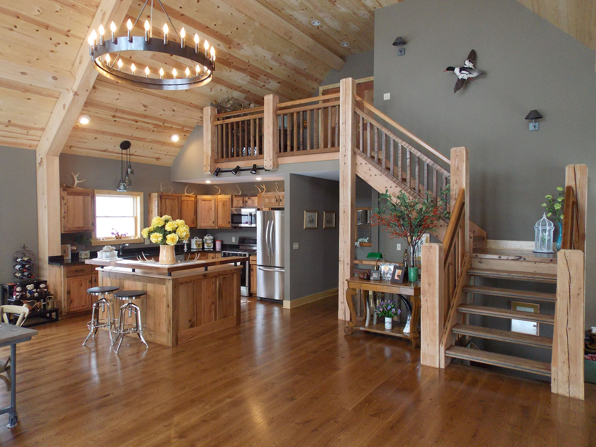 Open concept living space lofty mountain homes - Cabin floor concept ...