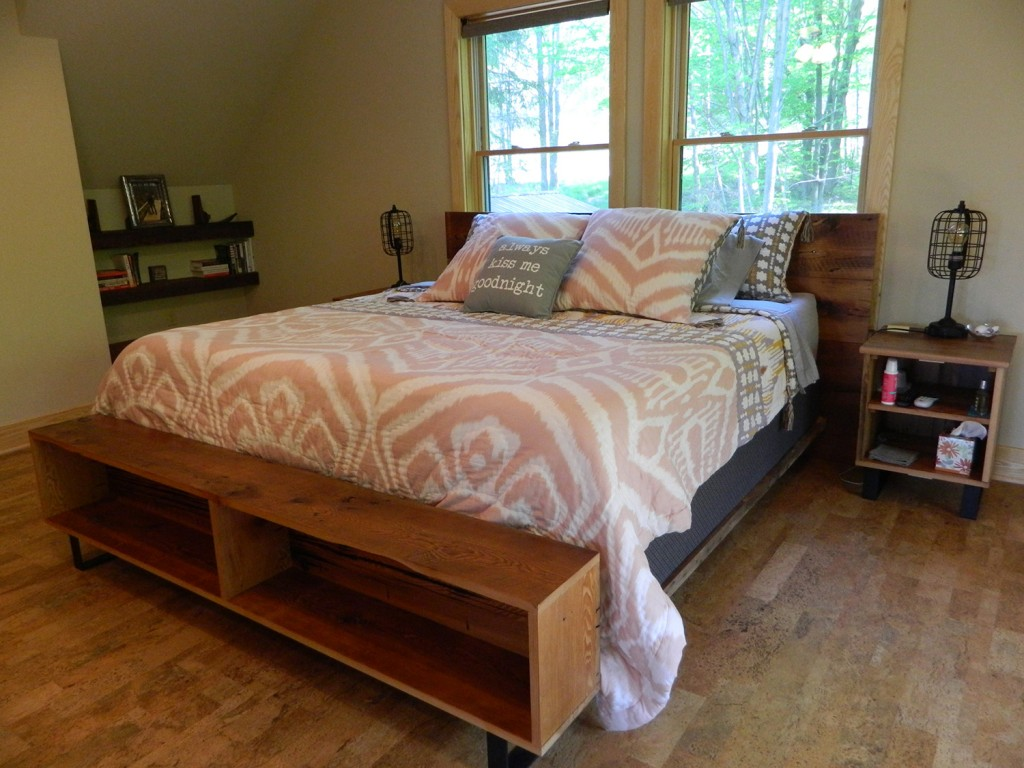This king-sized bed was crafted from 100-year-old barn wood that was milled by Amish craftsmen and sealed with clear coat poly for an authentic look. Note the cork flooring, which is quieter and easier to walk on than traditional flooring.