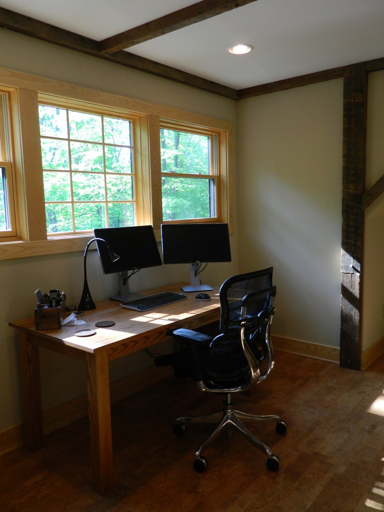 Designed to fit in a homeowner's loft space, this custom desk is made from oak boards from a nearby barn.
